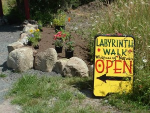 These welcome signs are placed along the roadway inviting folks to walk the labyrinth.